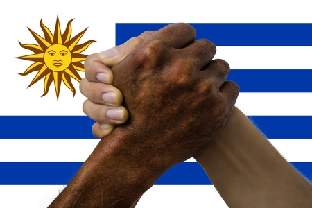 uruguay flag, intergration of a multicultural group of young people.
