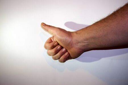 The gesture of a hand on white background, isolated.