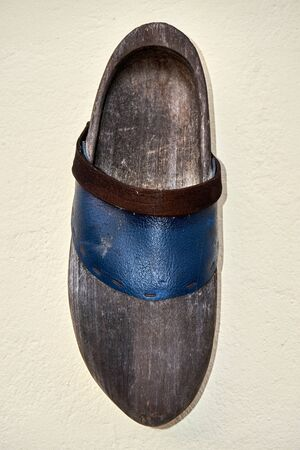 wooden shoe decoration on a white wall Reklamní fotografie