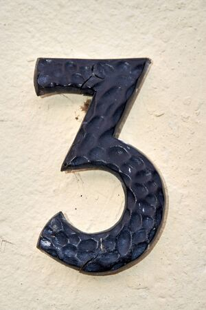 the number three on a house wall