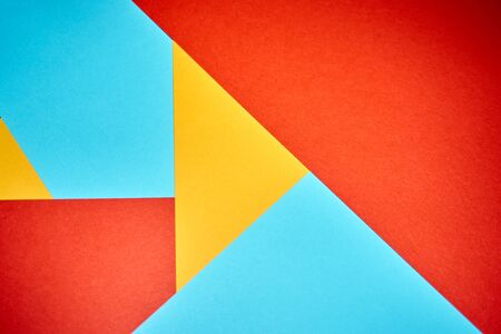 Colorful geometric texture paper pattern in yellow, blue, red.