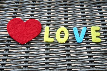 The word love is made of felt. Banque d'images - 149578473