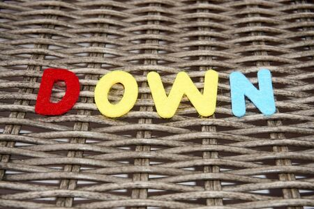 The word down is made of felt. Stock Photo