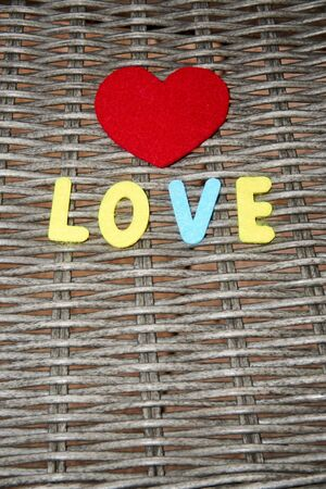 The word love is made of felt.