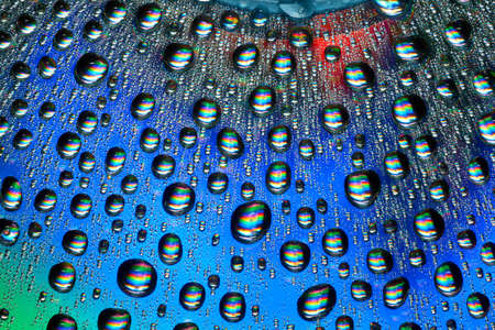 Macro of water drops on multicolor background.