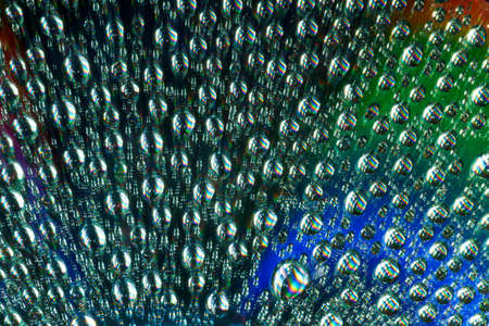 Macro of water drops on multicolor background