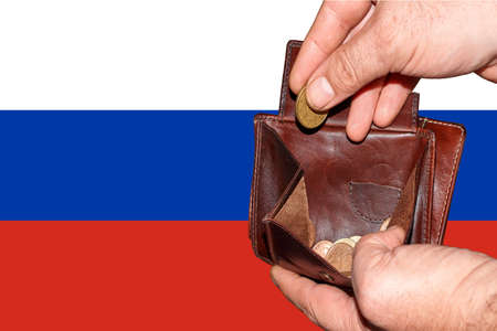 empty wallet shows the global financial economic crisis triggered by the corona virus in Russia.