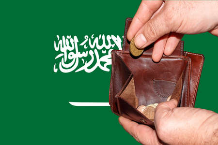 empty wallet shows the global financial economic crisis triggered by the corona virus in Saudi Arabia.