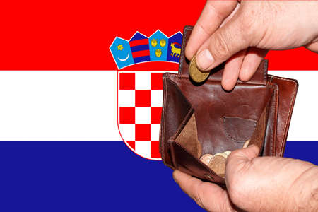 empty wallet shows the global financial economic crisis triggered by the corona virus in Croatia.