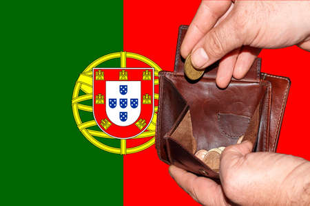 empty wallet shows the global financial economic crisis triggered by the corona virus in Portugal.