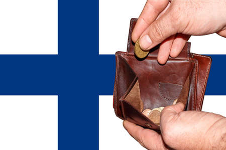 empty wallet shows the global financial economic crisis triggered by the corona virus in Finnland.
