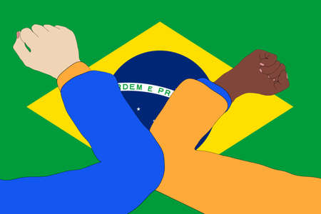 Elbow bump. New, innovative greeting to avoid the spread of the coronavirus in front of a Brazil flag.