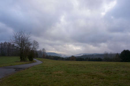 Landscape photo in rainy weather with fog and clouds in spring.