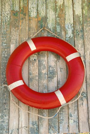 Life buoy hanged on wooden wall Standard-Bild