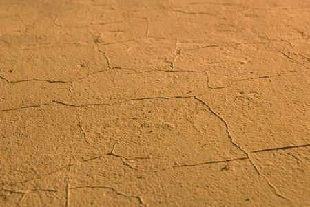 Dried cracked yellow texture, climate changing metaphor photo