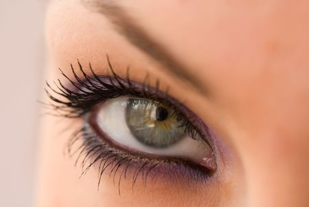 dilate: beautiful woman`s open colorful eye Stock Photo