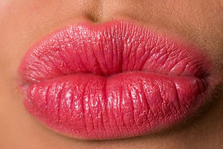 Close up shot of young woman making her lips cupids bow