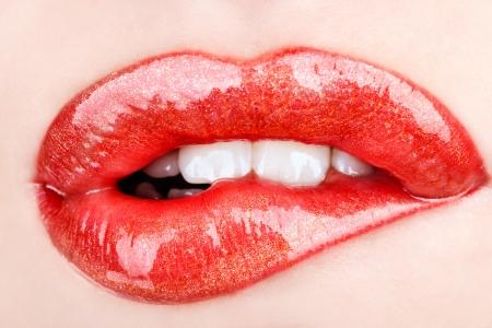 Biting her red lips teeth photo
