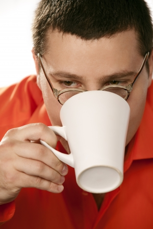 Portrait of funny businessman drinking coffee Stock Photo - 13887977