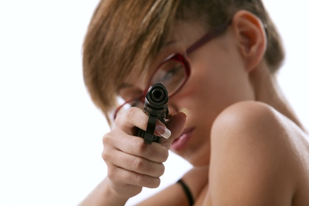 The pretty woman in red glasses taking aim from a gun photo