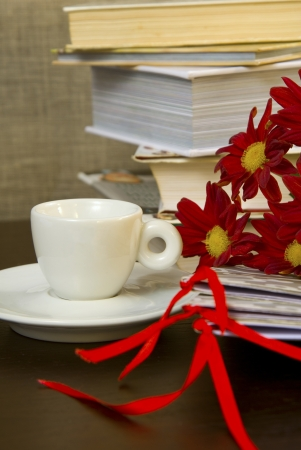 composition with coffe cup andbooks photo