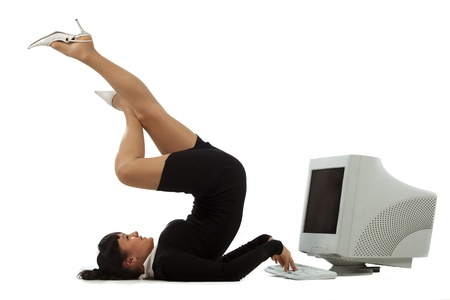 Flexible businesswoman with laptop computer over white background photo