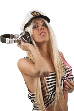 Portrait of sexy girl with peak-cap on her head listening a headphone photo
