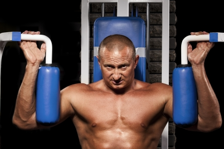 pectoral muscle: Fitness - powerful muscular man doing weightlifting in gym  Stock Photo