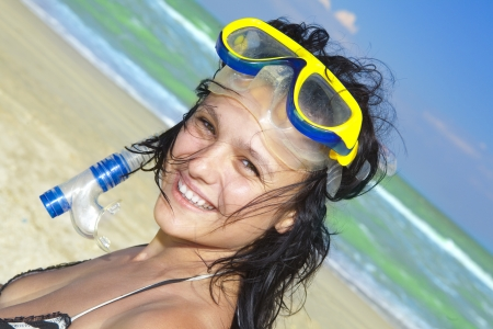 Happy diving girl in a swimming mask and snorkel photo