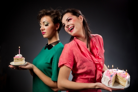 Two glamour girls with cake. photo