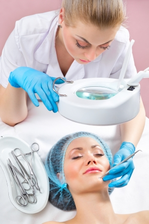 blackhead: Blackhead cleansing on woman face during facial treatment at beauty clinic