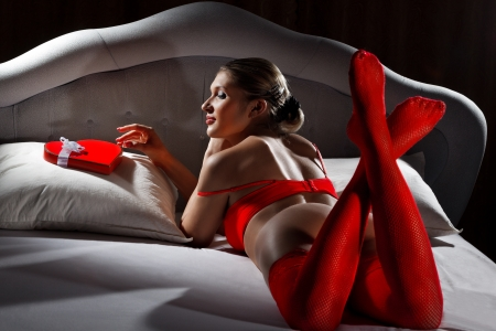 Woman with gift in Valentines day photo