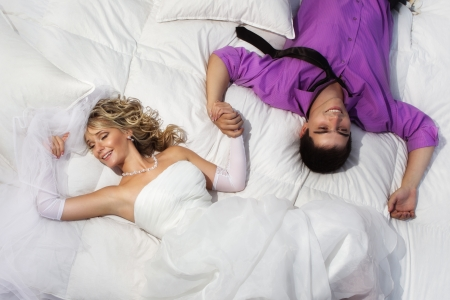 Beautiful young couple resting in bed  Standard-Bild