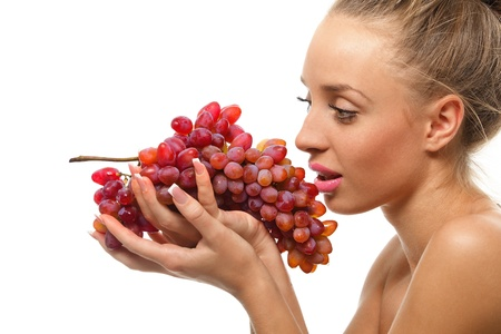 Beautiful young woman holding a bunch of red grapes photo