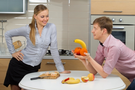 Happy Couple having fun on a kitchen.Dieting concept.Healthy eating photo
