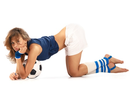 Sexy girl doing fitness with soccer ball over white background photo