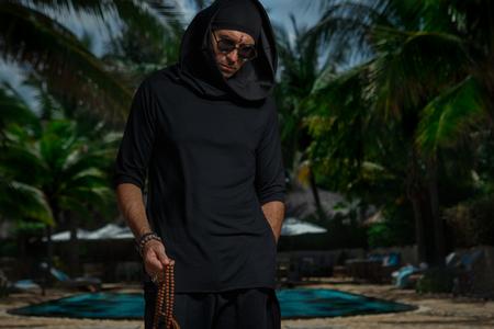 Freak in black costume