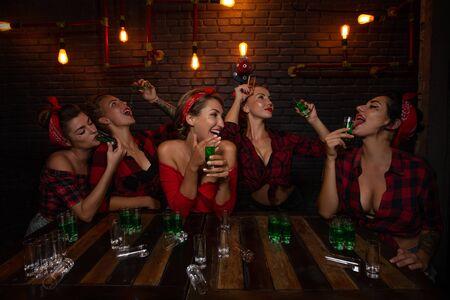 Pin up girls in nightclub having fun Stock Photo