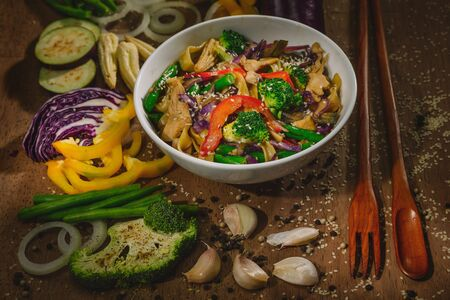Wok stir fry vegetables with chicken and noodles