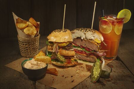 a set of beef burger with drinks