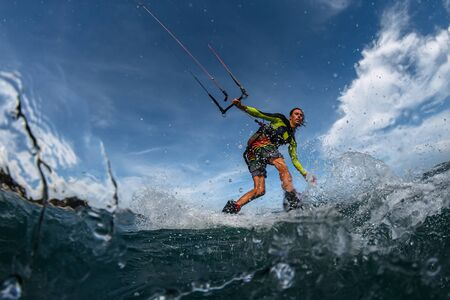 Kite surfer on the waves