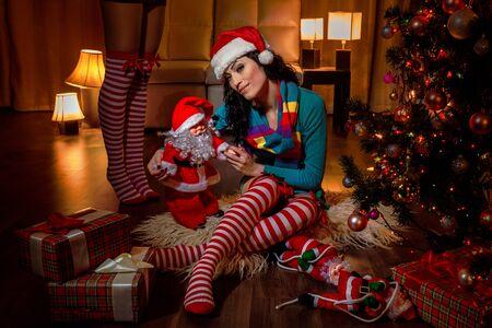 Beautiful Santa helper by the christmas tree