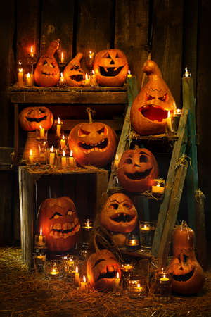 Scary Jack O 'Lantern Halloween pumpkins on a wooden background Standard-Bild