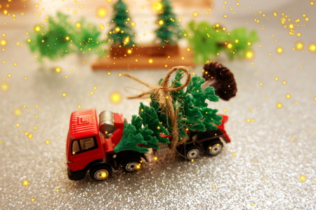 christmas background,red toy truck carry on christmas tree on sparkling background