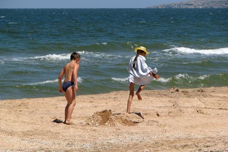 Running children. Playing children on the beach. The long vacation