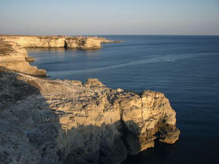 Cliffs by the sea.  Rocky seacoast and evening calm. Holiday season. Marine.