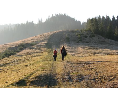 Family walk in the autumn. Hike in the mountainous meadows. Stock Photo
