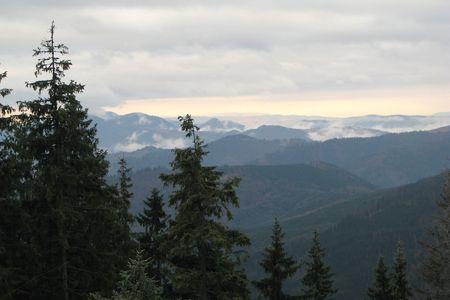 Misty ridge. Grey chain of mountains. Birds-eye view. Mountainous landscape