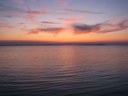 Afterglow. Evening calm on the Sea of Azov. Bright afterglow