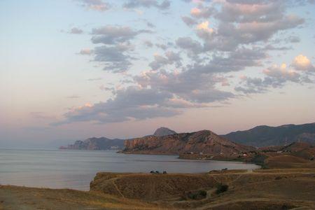 Early morning. Cloud-drift over South Coast of Crimea. Morning twilight in the coast of Black Sea. Stock Photo - 6348083